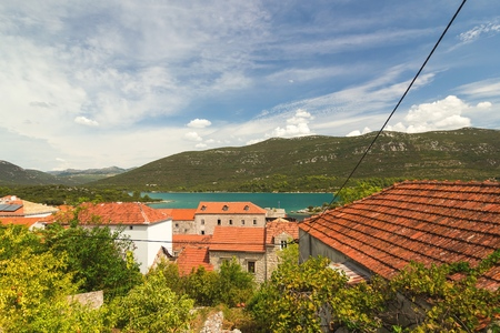 sea of houses: Traditional Mediterranean houses with red tiled roofs and Adriatic Sea, Dalmatia, Croatia, Europe Stock Photo