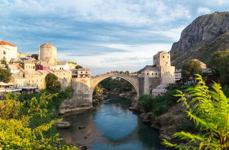 Beautiful landscape of the historic town of Mostar in the lights of the sunset, valley of the Neretva River, Bosnia and Herzegovina