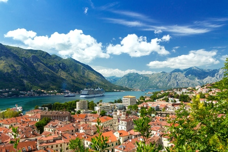 Top view of the old town and big ship in Kotor Bay, Montenegro