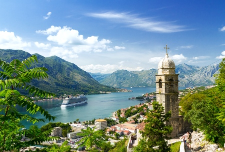 Church tower and venetian architecture of an old Mediterranean town, Bay of Kotor, Montenegro