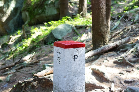 Boundary border mountain stone between Poland and Czech Republic