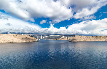 Sky with clouds and summer day, Pag bridge in Croatia, Europe