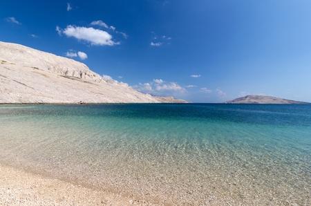 Beautiful tropical beach blue water white mountains