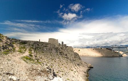 Ruine of fortress and the Pag bridge, Island of Pag, Croatia, Europe