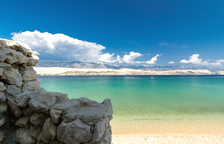 View from behind the stone wall on the beautiful blue Adriatic sea, Croatia