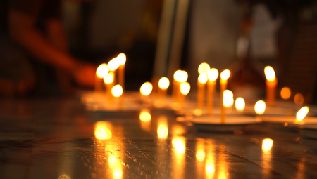 Defocused blur of candle light in thai temple