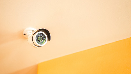 CCTV Security camera equipment on house or shop ceiling and space for text