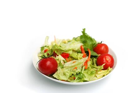 sallad: Mixed sallad and tomatoes in a bowl Stock Photo