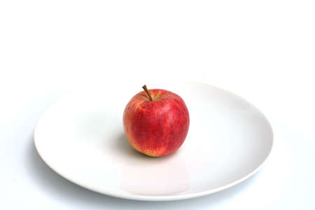 Apples shot in various setups on a white plate