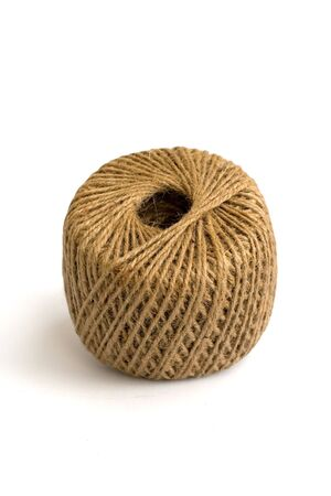 close ups: A ball of twine on a white background and close ups in Macro