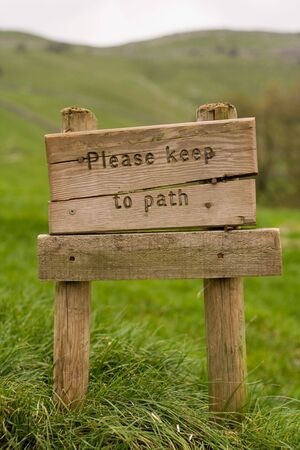 Signpost reading Please Keep to the Path Stock Photo