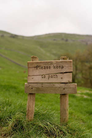 Signpost reading 'Please Keep to the Path' Stock Photo - 718681
