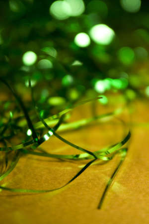 differing: Two classice Christmas colours, Green and Gold festive background with selective focus and differing depths of field, good design element with space for copy.