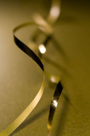 Christmas wrapping ribbon design element, selective focus and carefull depth of field makes for interesting design element of christmas card image.