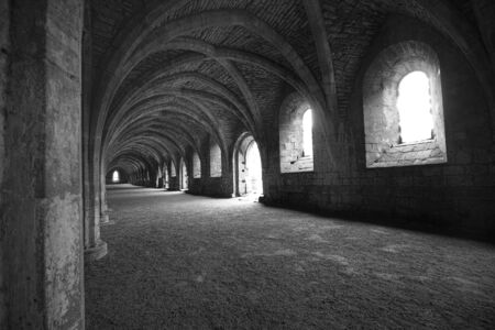 ghostly: Vaulted ceilings in Fountains Abbey in North Yorkshire, shot with natural lighting from Tripod with 10-20mm lens. Old broken down abbey and surounding grounds. Ancient Gothic arches