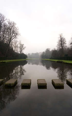 Stepping Stones at Fountains Abbey in North Yorkshire, old broken down abbey and surounding grounds Stock Photo