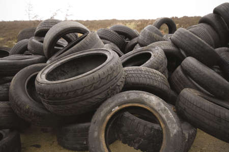 outrage: old car tyres dumped on the moor by a fly-tipper