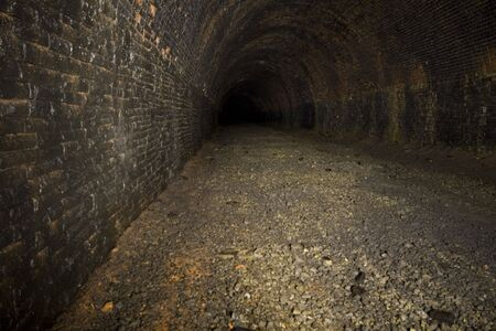 torches: Underground Light painting in disused railway tunnels, darkness creatively lit with torches.