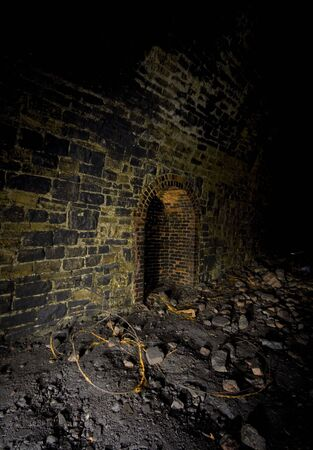 creatively: Refuge or passing place, Underground Light painting in disused railway tunnels, darkness creatively lit with torches.