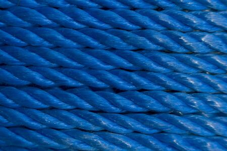 coiled rope: Coiled Blue Nylon Rope background Stock Photo
