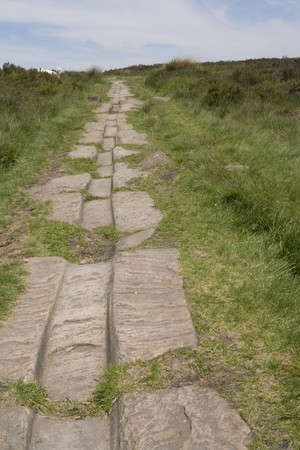 Ancient roman road and cart tracks worn into the stone. Harden Moor, Haworth, West Yorkshire, UK