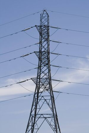Electricity Distribution Pylons on a summers day with blue skys.