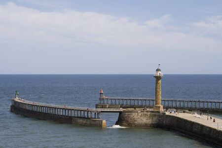 Whitby Harbour on summer day, looking out to sea. North Yorkshire, UK Stock Photo