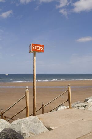 Steps sign on Sea front at Whitby, North Yorkshire