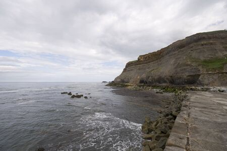View from Whitby harbour sea wall, North Yorkshire Tourist destination. Shot with a 10mm wide angle lens. Stock Photo