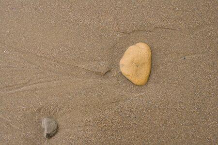 Pebbles on Sand background, beach textures.