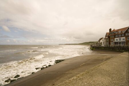 Stormy sea at Sandsend near Whitby in North Yorkshire, looking down the beach.