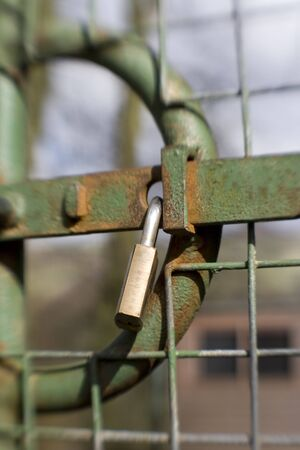 Sweetspot focus on Locked Gate padlock.