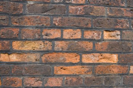 Old Weathered Brick Wall Background, grunge texture.