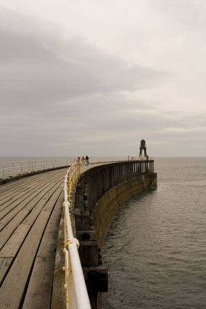 View of Whitby Harbour, overcast sky. Boardwalk out to sea. Stock Photo - 4794351