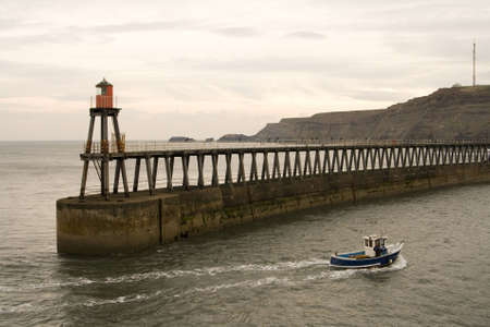 View of Whitby Harbour, overcast sky, With boat. Stock Photo - 4794339