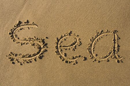 Writing in the Sand, with the word Sea