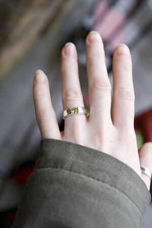 Girls hand with Engagement ring with peridot stone Stock Photo - 4794363