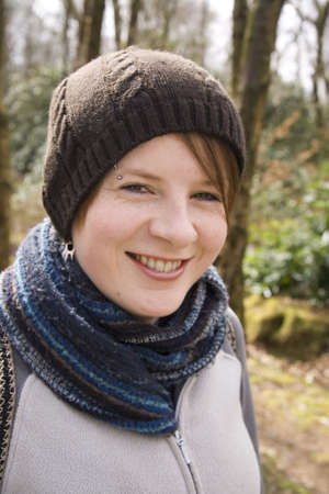 wrapped up: Happy Girl wrapped up in hat and scarfe out in the woods and countryside.