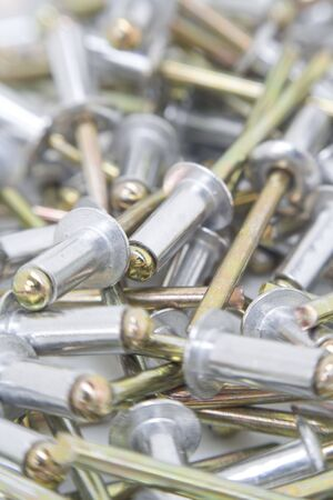 Multiple aluminium rivets close up. Stock Photo - 5870020