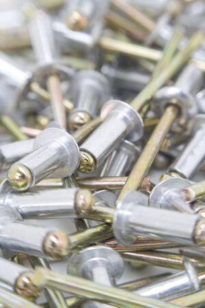 Multiple aluminium rivets close up. Stock Photo