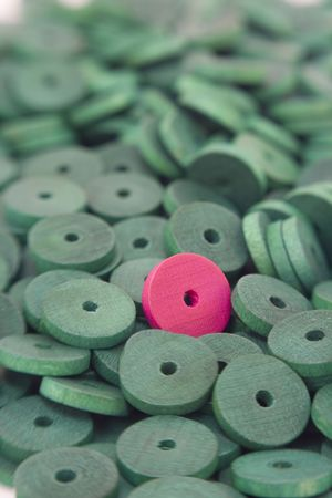 Coloured wooden beads background, shot with sweetspot lens with shallow depth of field. Stock Photo