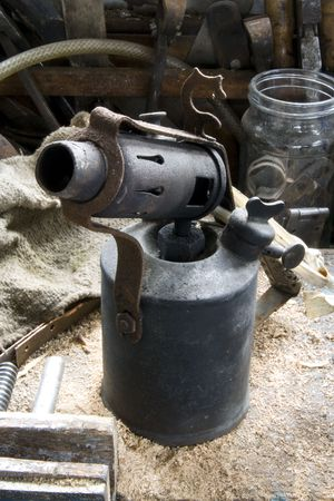 Old Blow lamp on workbench, parafin blow torch for removing paint