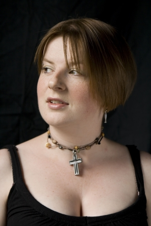 Girl with Black top and cross necklace set on black background. Stock Photo - 5885342
