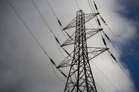 Electricity Pylon clouds and sky, power distribution.