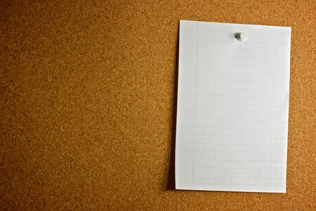 cork board: A single piece of paper posted on a corkboard, with room to the left for additional messages