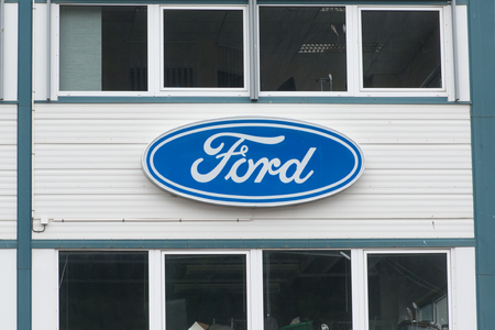 automaker: Andalsnes, NORWAY - CIRCA JUNE, 2016: Ford dealer sign at the entrance of the building. The Ford Motor Company is an American multinational automaker founded by Henry Ford in 1903.
