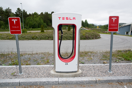 throughout: TINGVOLL, NORWAY - CIRCA JUNE, 2016: Tesla charging stations are located throughout EU to accommodate owners of the electric car.