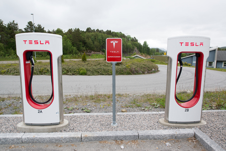 supercharger: TINGVOLL, NORWAY - CIRCA JUNE, 2016: Tesla charging stations are located throughout EU to accommodate owners of the electric car.