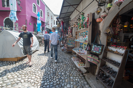 MOSTAR, BOSNIA AND HERZEGOVINA - Circa july 2016: Tourist and locals walking on on streets of the town of Mostar. Included to the UNESCO heritage