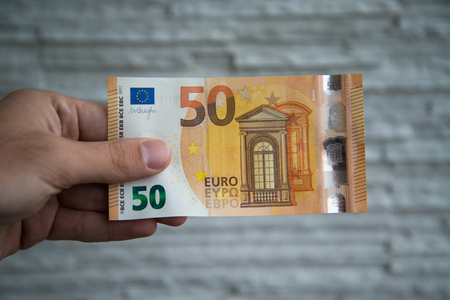 Man holding new 50 euro banknote released on 4 april, 2017